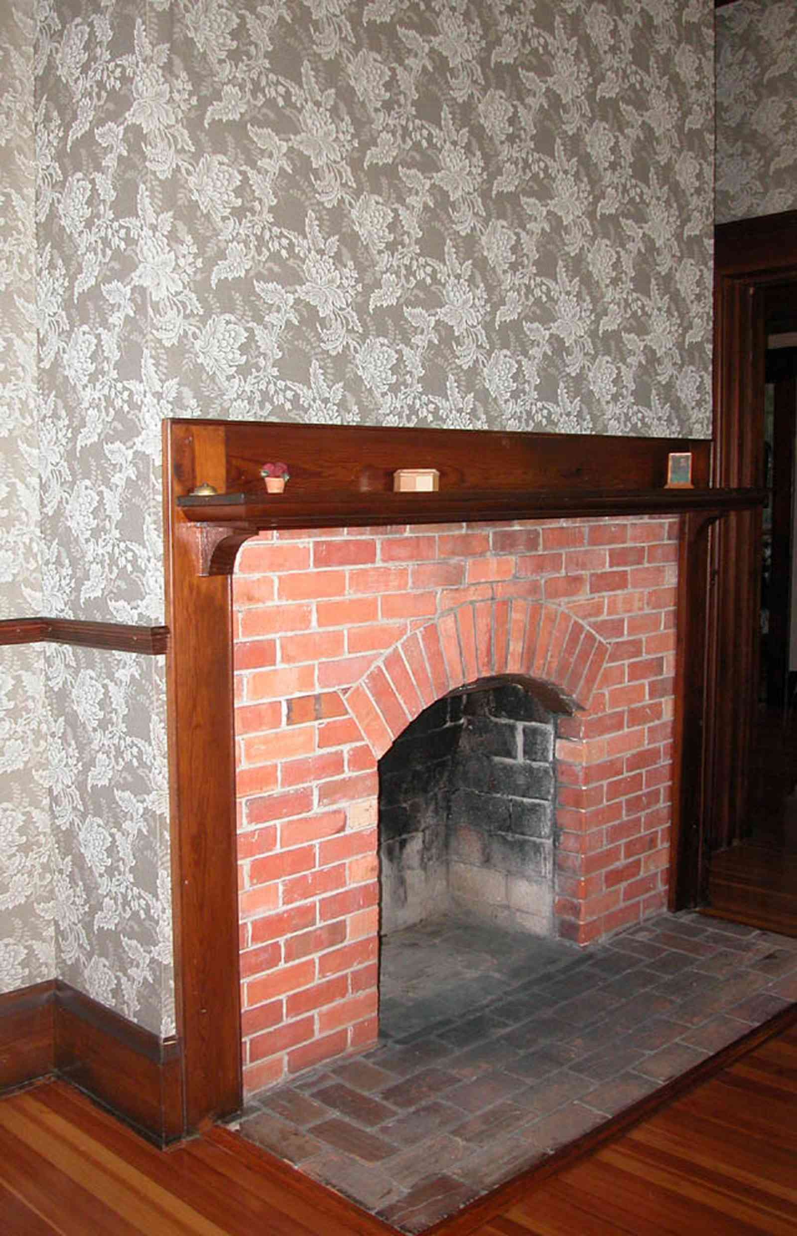 Century:-Tannenheim_01o.jpg:  fireplace, brick fireplace, damask wallpaper, wooden floor, heart pine flooring, mansion, plantation house