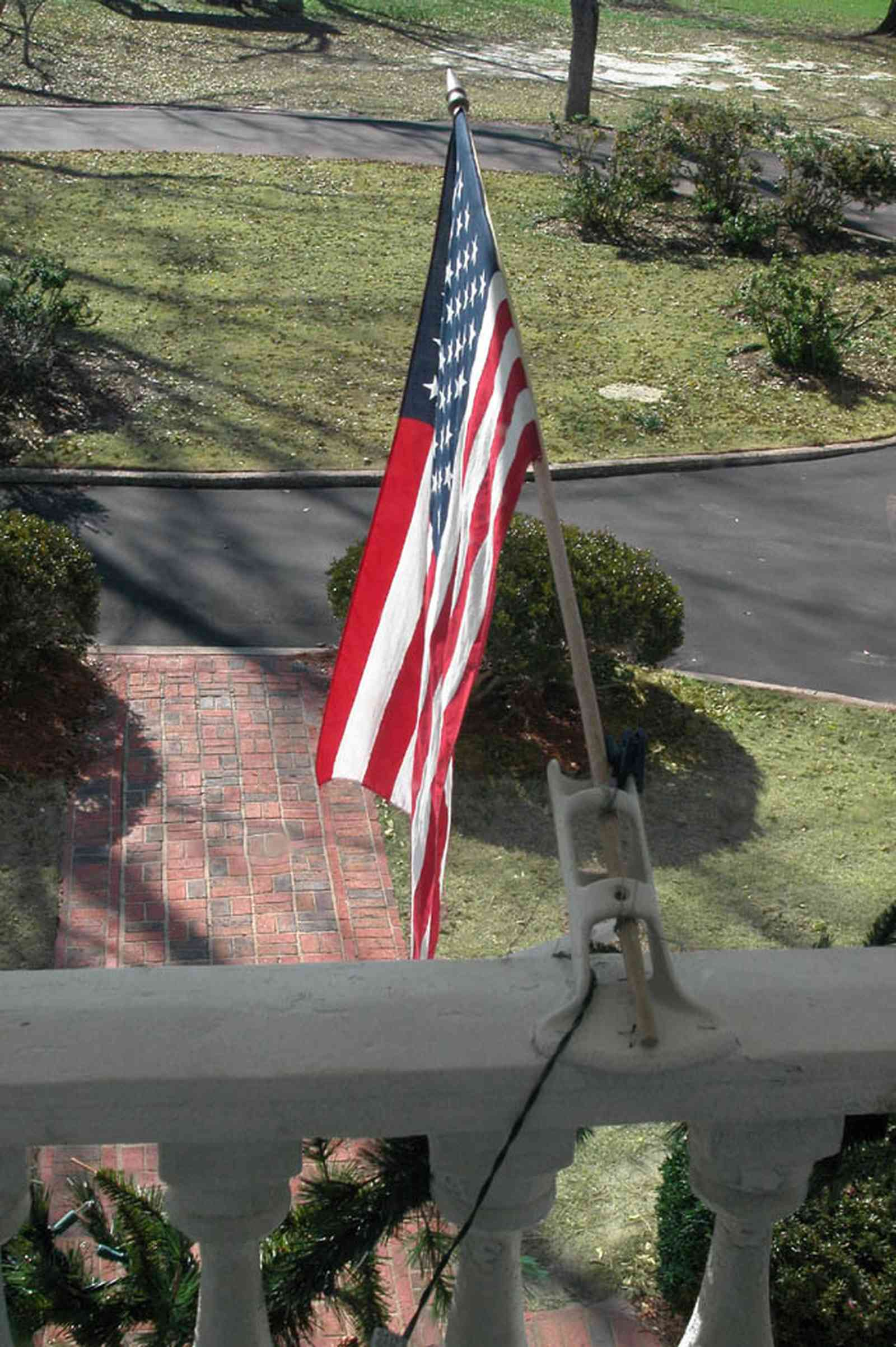 Century:-Tannenheim_01w.jpg:  balcony, american flag, balustrade, brick sidewalk, driveway, mansion, plantation home