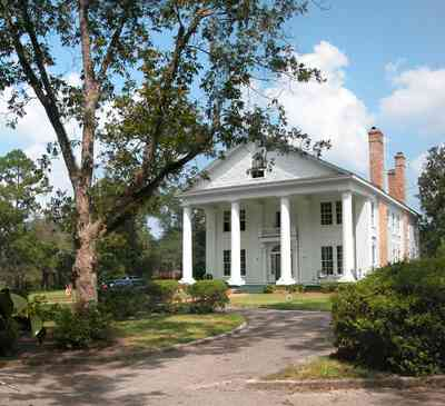 Century:-Tannenheim_02b.jpg:  victorian mansion, southern mansion, white columns, heart pine wood, tongue and groove walls, pasture, lake pecan orchard, plantation, rolling pastures, timber, hedge, azalea bush, country road