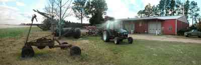 Davisville:-Beck-Sod-Farm_06.jpg:  catfish pond, fir tree, shed, windmill, sod, turf
