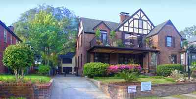 East-Hill:-1804-East-La-Rua-Street_03.jpg:  english tudor architecture, balcony, bay, carriage house, azalea bush