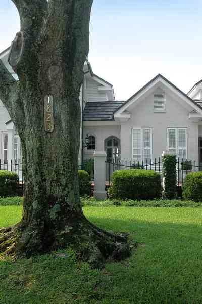 East-Hill:-1823-East-La-Rua-Street_01.jpg:  oak tree, shutters, front porch, bayshore, wrought-iron fence,