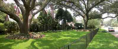 East-Hill:-1919-East-La-Rua-Street_01.jpg:  wrought-iron fence, oak trees, tudor style, oak trees, red brick house,