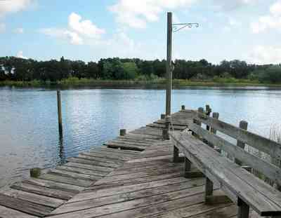 East-Hill:-1919-East-La-Rua-Street_08.jpg:  deck, bench, bayou, swamp, sawgrass, bayou texar, cumulus clouds, fishing pier,