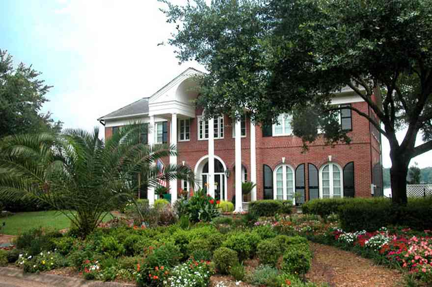 East-Hill:-2000-Whaley-Avenue_01.jpg:  red brick house, impatiens, box hedges, oak trees, columns, shutters, red brick,