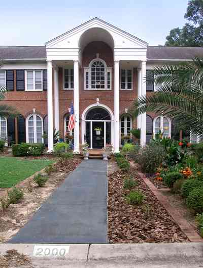 East-Hill:-2000-Whaley-Avenue_03.jpg:  red brick house, impatiens, box hedges, oak trees, columns, shutters, classical style,