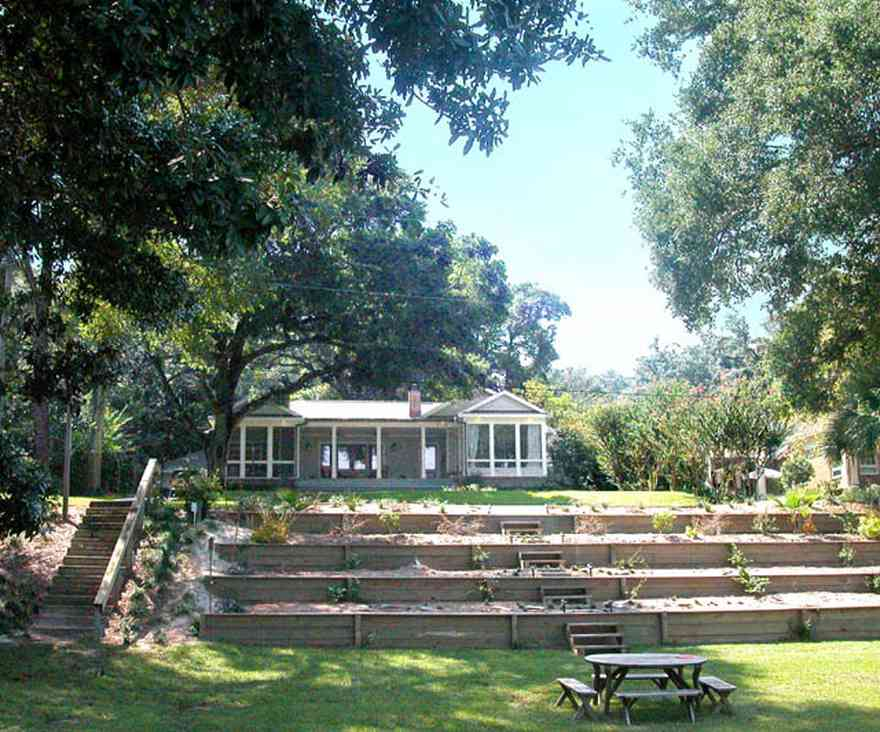 East-Hill:-2109-Whaley-Drive_01.jpg:  picnic table, ranch style home, front porch, oak trees, glassed-in porch