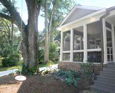 East-Hill:-2109-Whaley-Drive_12.jpg:  oak tree, tree swing, front porch, screen porch, ranch style home, bayou