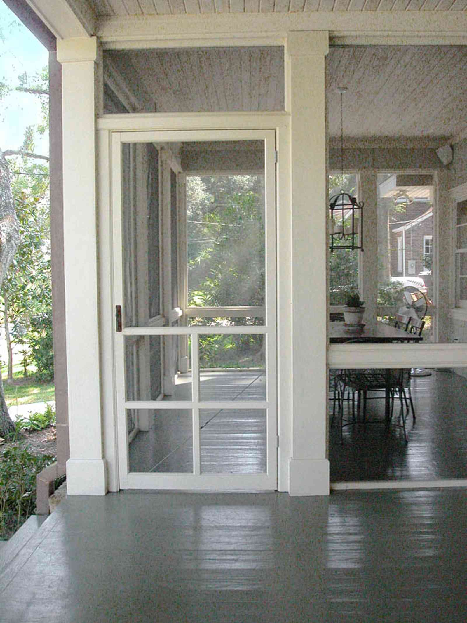 East-Hill:-2109-Whaley-Drive_13.jpg:  screen porch, wooden floor, painted floor, front porch