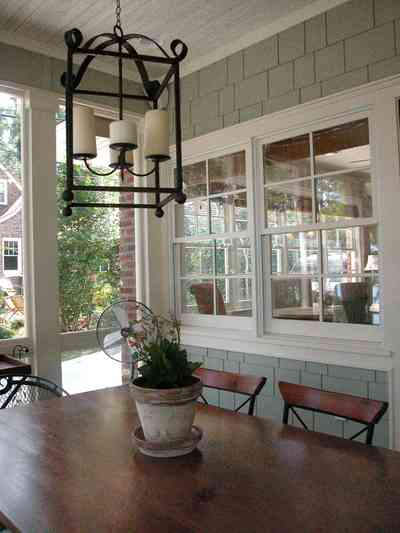 East-Hill:-2109-Whaley-Drive_15.jpg:  flower pot, dining table, shingles, wrought-iron lantern, candles, screen porch