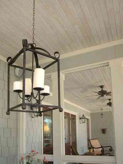 East-Hill:-2109-Whaley-Drive_17.jpg:  wrought-iron lantern, ceiling fan, wooden shingles, ranch-style home