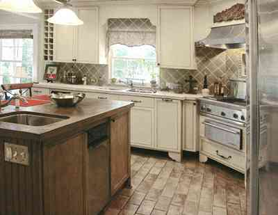 East-Hill:-2109-Whaley-Drive_26.jpg:  kitchen island, stainless appliances, ceramic tile, porcelin tile, wine rack