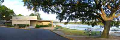 East-Hill:-Bayview-Park_02.jpg:  community center, oak tree, boardwalk, pier, dock, escambia county park, bayou texar, playground