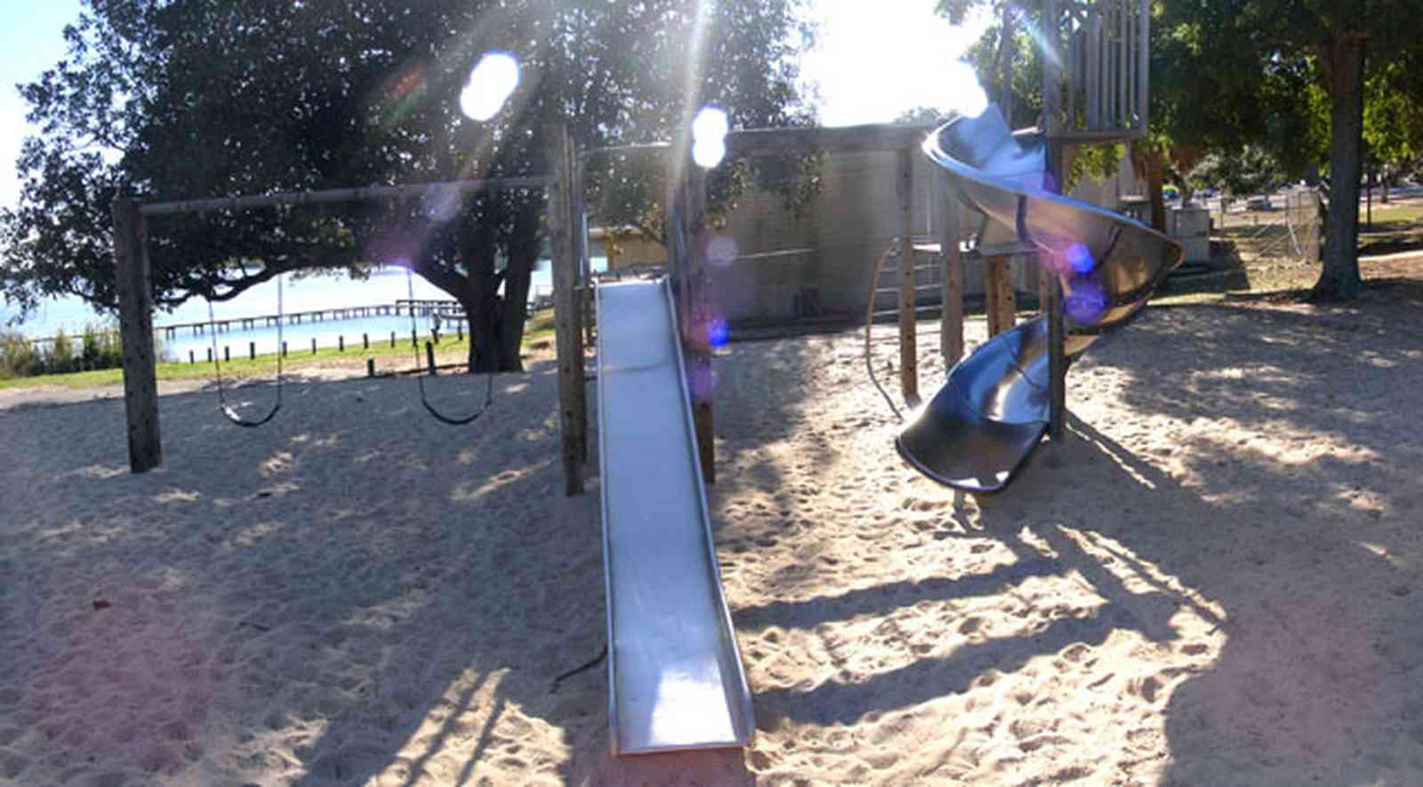 East-Hill:-Bayview-Park_10.jpg:  slide, tree house, magnolia tree, oak tree, bayou texar, escambia county, sand box, corkscrew slide, swing