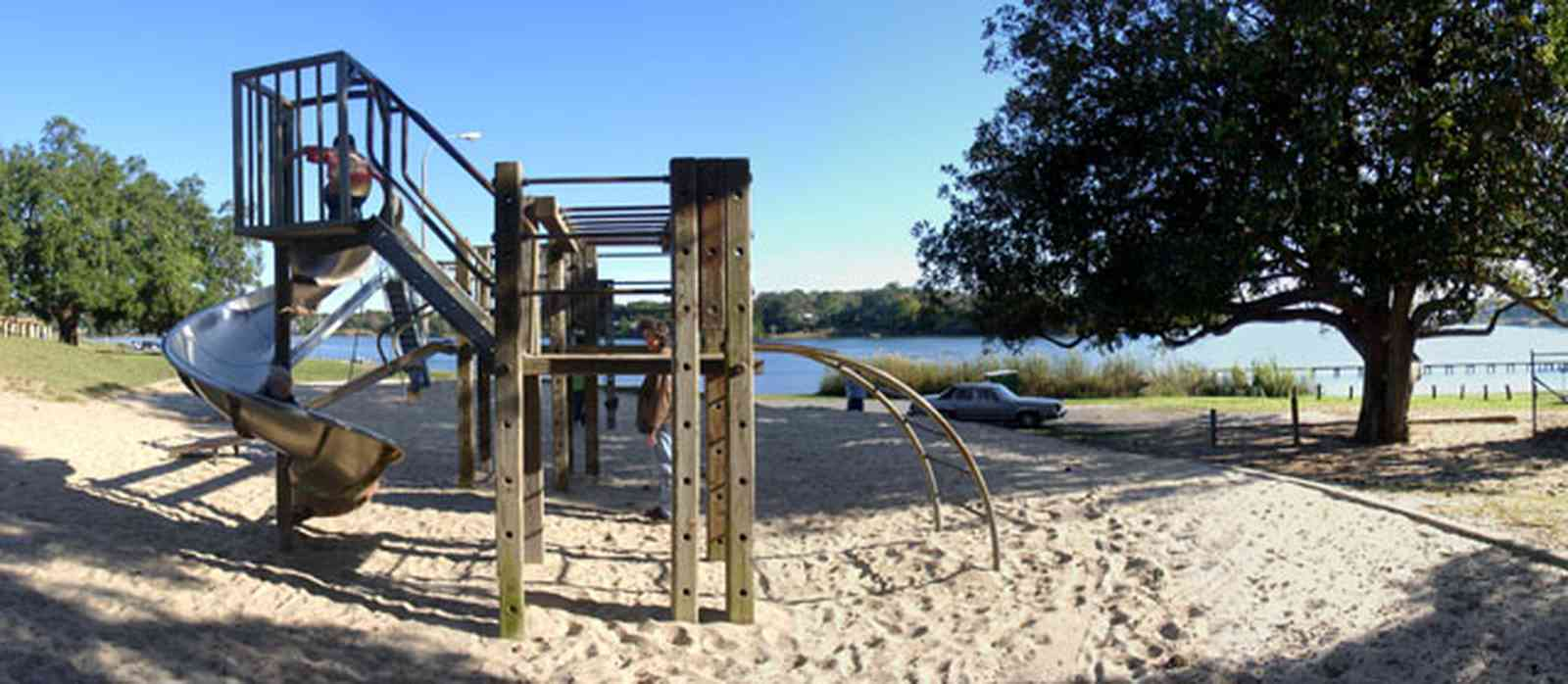 East-Hill:-Bayview-Park_11.jpg:  gulf coast, magnolia tree, oak tree, slide. bayou texar, sand, playground equipment
