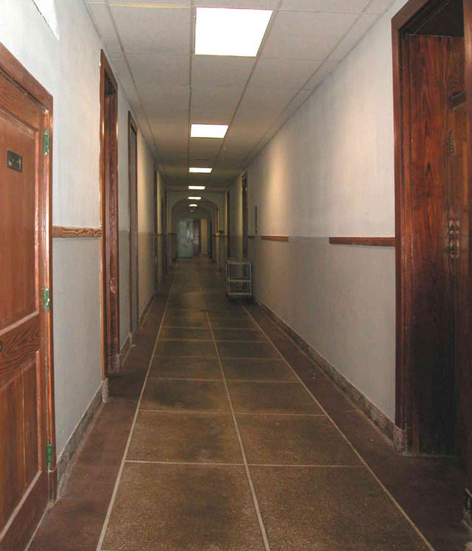 East-Hill:-Tower-East:-Old-Sacred-Heart-Hospital_38.jpg:  granite floor, hallway, gothic revival architecture, wooden doors