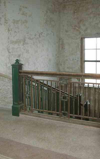 East-Hill:-Tower-East:-Old-Sacred-Heart-Hospital_49.jpg:  metal balustrade, staircase, granite floors, plaster walls