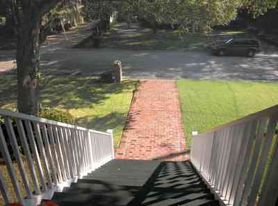 East-Pensacola-Heights:-112-Chipley-Avenue_03.jpg:  staircase, raised cottage, brick sidewalk, oak tree