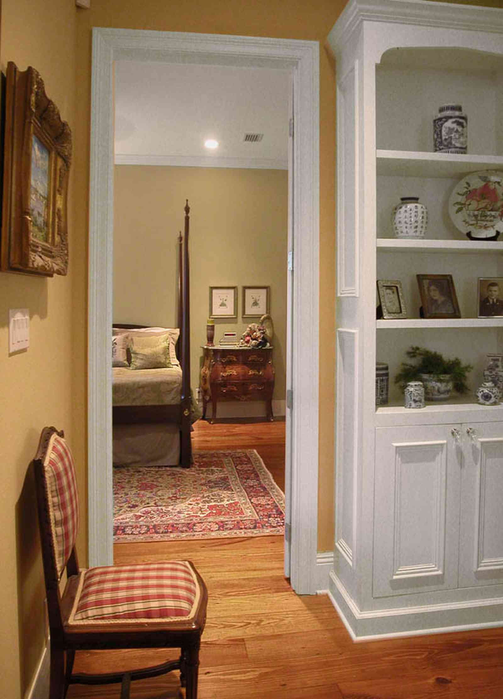 East-Pensacola-Heights:-112-Chipley-Avenue_07.jpg:  four poster bed, oriental rug, cupboard, library, heart-pine floors