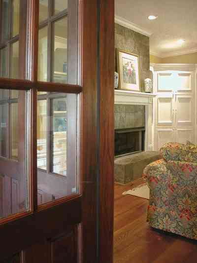 East-Pensacola-Heights:-112-Chipley-Avenue_08.jpg:  heart-pine floor, marble mantle, cupboard, french doors, screen porch