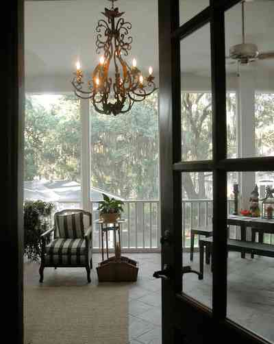 East-Pensacola-Heights:-112-Chipley-Avenue_09.jpg:  chandelier, slate floor, ceiling fan, screen porch, raised cottage