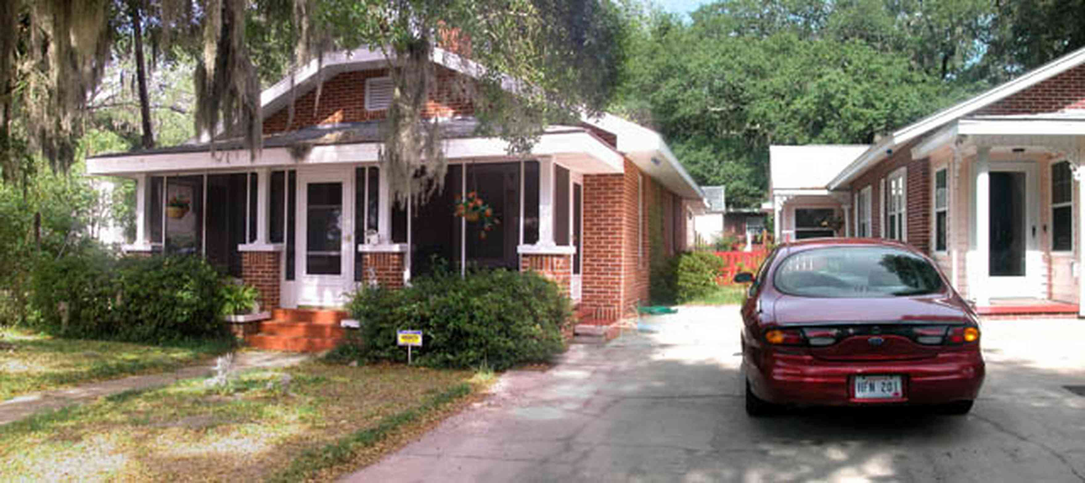 East-Pensacola-Heights:-118-Bayou-Blvd_01.jpg:  craftsman cottage, spanish moss, bayou texar, oak tree, red brick house