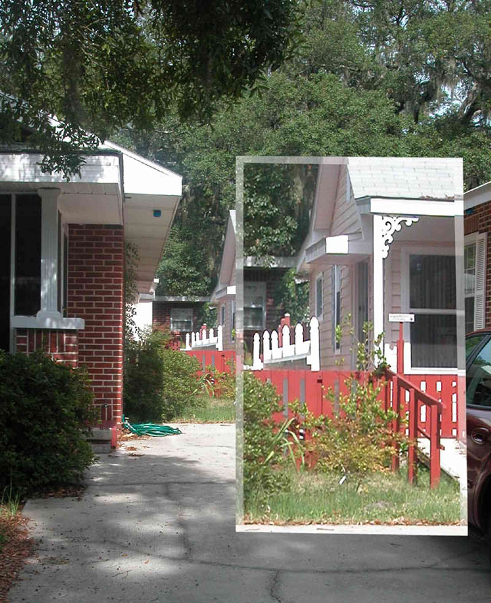 East-Pensacola-Heights:-118-Bayou-Blvd_02.jpg:  craftsman cottage, spanish moss, bayou texar, oak tree, red brick house