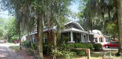 East-Pensacola-Heights:-118-Bayou-Blvd_03.jpg:  craftsman cottage, spanish moss, bayou texar, oak tree, red brick house