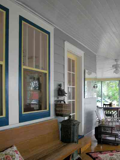 East-Pensacola-Heights:-600-Bayou-Blvd_05.jpg:  front porch, pine bench, heartpine floor, wicker furniture, french door, floral cushion