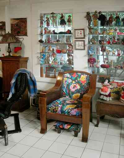 East-Pensacola-Heights:-600-Bayou-Blvd_18.jpg:  antique dolls, antique toys, ceramic tile floors, family room