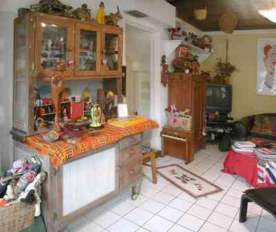 East-Pensacola-Heights:-600-Bayou-Blvd_20.jpg:  display cabinet, white ceramic tile floor, wooden ceiling, antique toys, antique dolls, family room