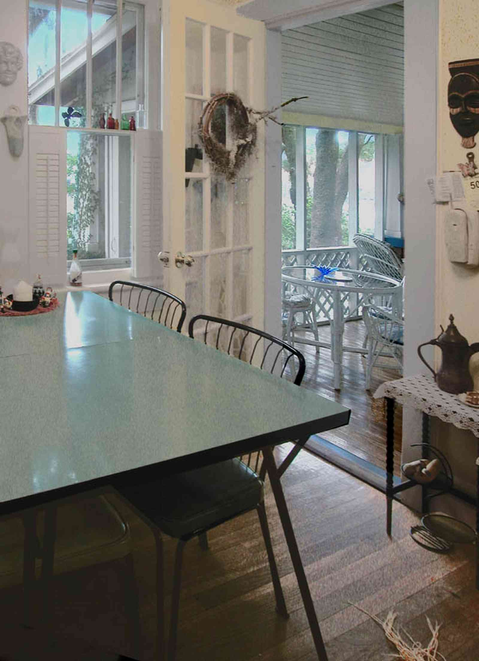 East-Pensacola-Heights:-600-Bayou-Blvd_21.jpg:  dining room, screened-in porch, shutters, french door, bayou view