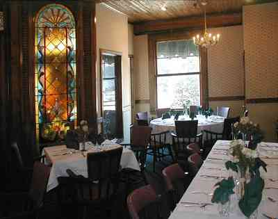 Foley:-The-Gift-Horse-Restaurant_02.jpg:  brass chandelier, beaded pine walls, buffet table, banquet table, silver compote, stained glass windows, table linen, restaurant