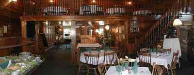 Foley:-The-Gift-Horse-Restaurant_03.jpg:  brass chandelier, beaded pine walls, buffet table, banquet table, silver compote, restaurant