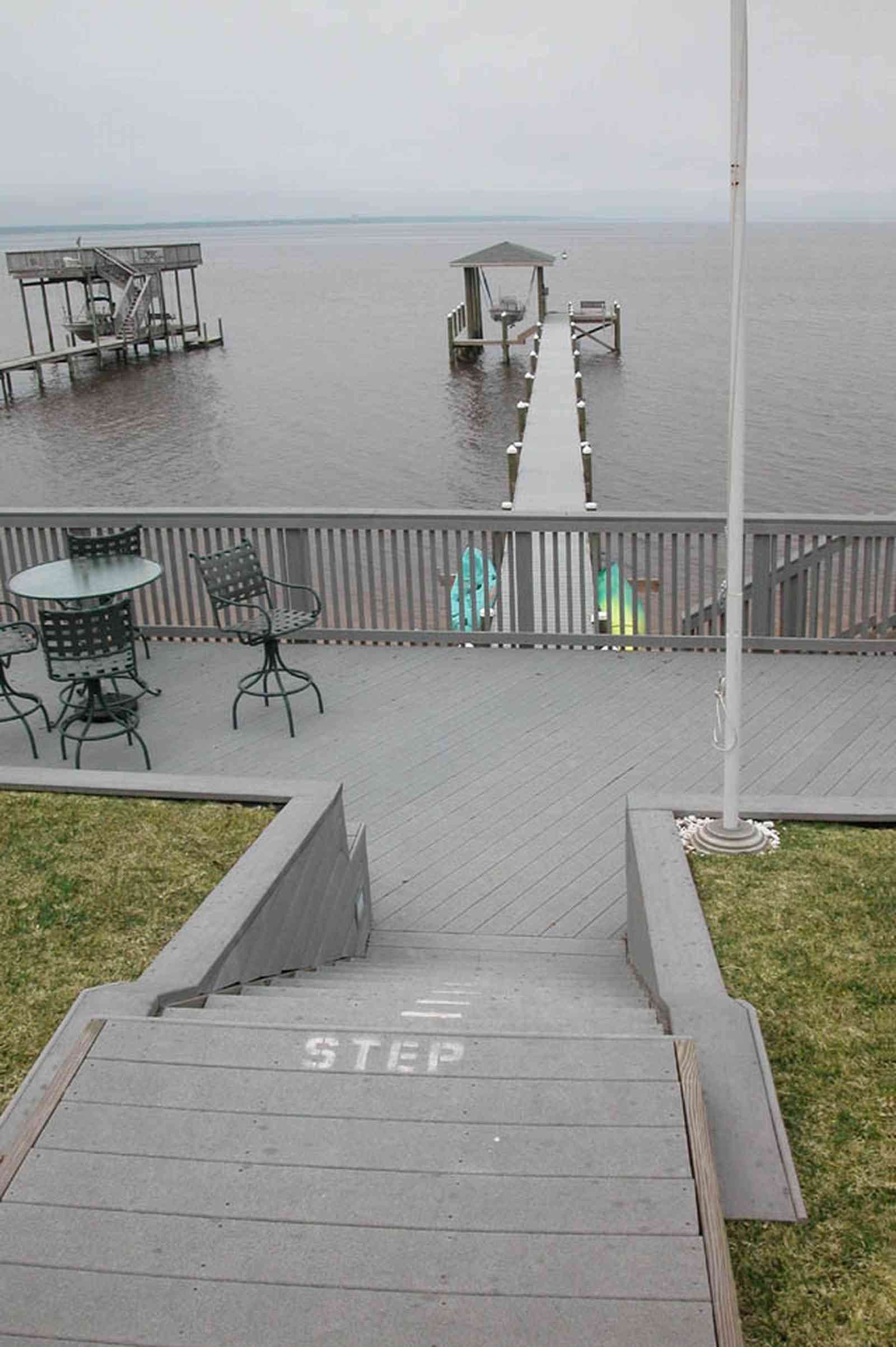 Gulf-Breeze:-228-North-Cliff-Dr_05.jpg:  swimming pool, bay, dock, pier, deck, flag pole, boat, bayfront