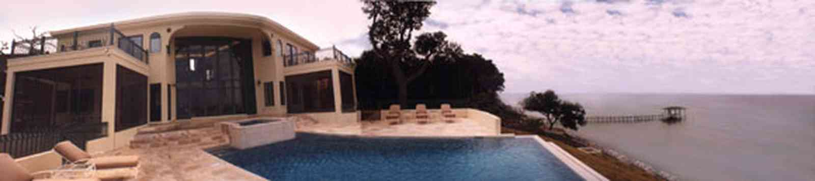 Gulf-Breeze:-Couch-Dreams_pool.jpg:  turret, dormer windows, pyramidal roofgulf coast, gulf of mexico, swimming pool, northern facade, swimming pool, marble decking