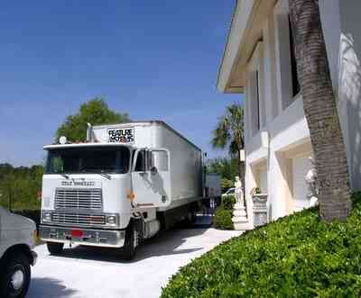 Gulf-Breeze:-Levin-House_13.jpg:  grip truck, palm tree, fred levin, roy jones