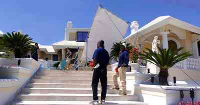 Gulf-Breeze:-Levin-House_14.jpg:  marble steps, roy jones, grecian statuary, palm tree