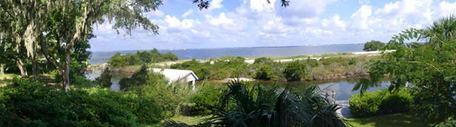 Gulf-Breeze:-Navy-Cove-House_04.jpg:  dead mans island, gulf coast, gulf breeze, gulf of mexico, boat house, spanish moss, sand bar, canal, mimosa tree