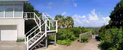 Gulf-Breeze:-Navy-Cove-House_05.jpg:  gulf coast, stairs, boat dock, palm, gulf of mexico, gulf breeze, boat launch trees, bay, channel, river, island garage, house