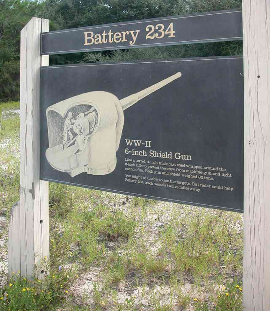 Gulf-Islands-National-Seashore:-Fort-Pickens:-Battery-234_00.jpg:  sign, kiosk, ww-ii emplacement, shield gun, sand, dune, gulf of mexico