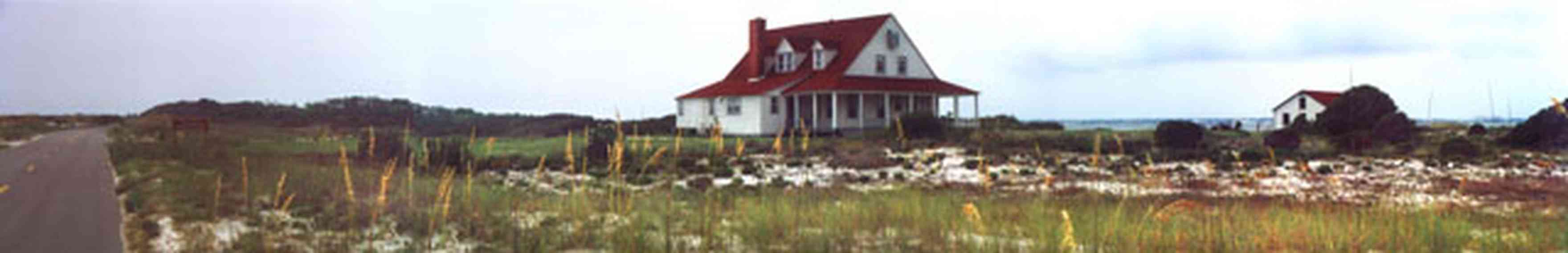 Gulf-Islands-National-Seashore:-Fort-Pickens:-Ranger-Station_03.jpg:  old coast guard station, fort pickens, gulf islands national seashore, dunes, sea oats, victorian house, red roof, dormer windows