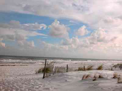 Gulf-Islands-National-Seashore:-Parking-Lot-9_04.jpg:  dune fence, gulf of mexico, mixed skies, quartz sand, surf, sea oats, barrier island