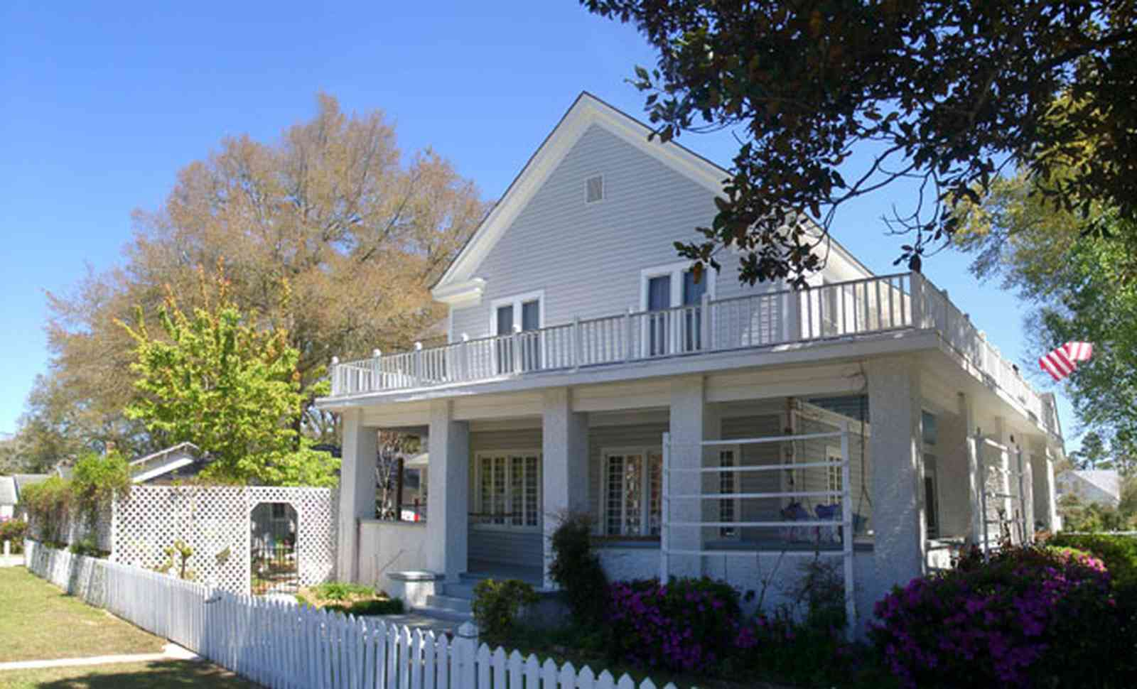 Milton:-Historic-District:-301-Pine-Street:-Butler-Potter-Schlenker-House_05.jpg:  wrap-around porch, arbor, azalea bushes, victorian home