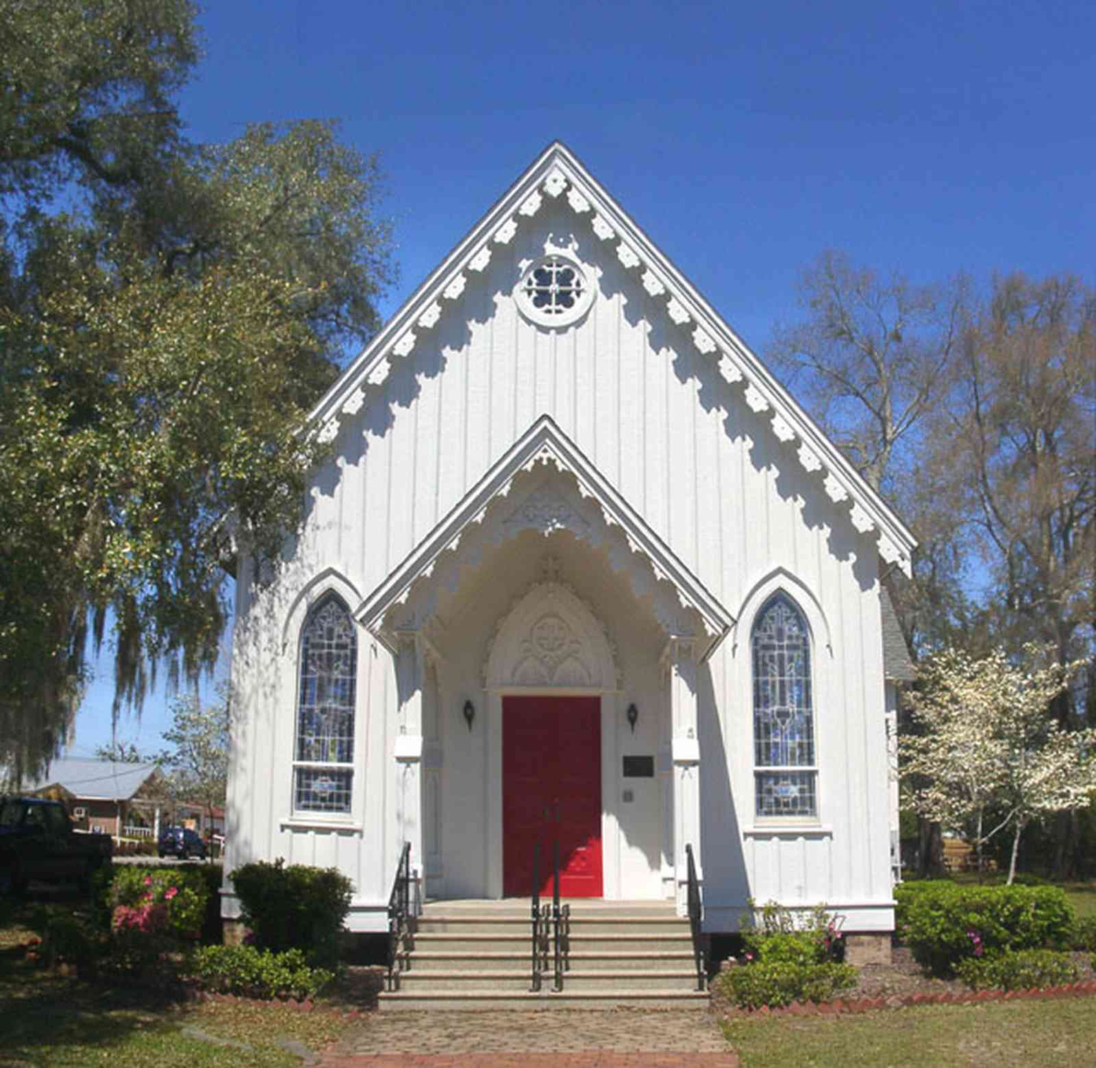 Milton:-Historic-District:-St.-Mary-Episcopal-Church_04.jpg:  gingerbread trim, victorian architectural style, dogwood tree, oak tree, spanish moss
