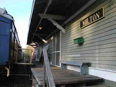 Milton:-L-N-Train-Depot_04.jpg:  train station, csx rail line, bench, dining car, caboose, train crossing