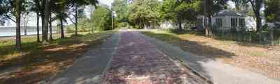 Milton:-Red-Brick-Road_10.jpg:  brick road, highway, two-lane road, red brick
