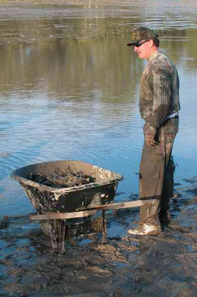 Milton:-Stewart-Farm_03.jpg:  shrimp, cast net, fish farm, wheelbarrow, mud, prawns