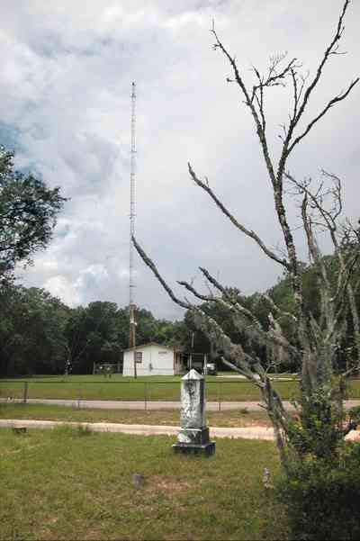 Milton:-WECM_01.jpg:  tombstone, radio tower, spanish moss, marble grave marker, dead tree, a.m. station, christian radio station