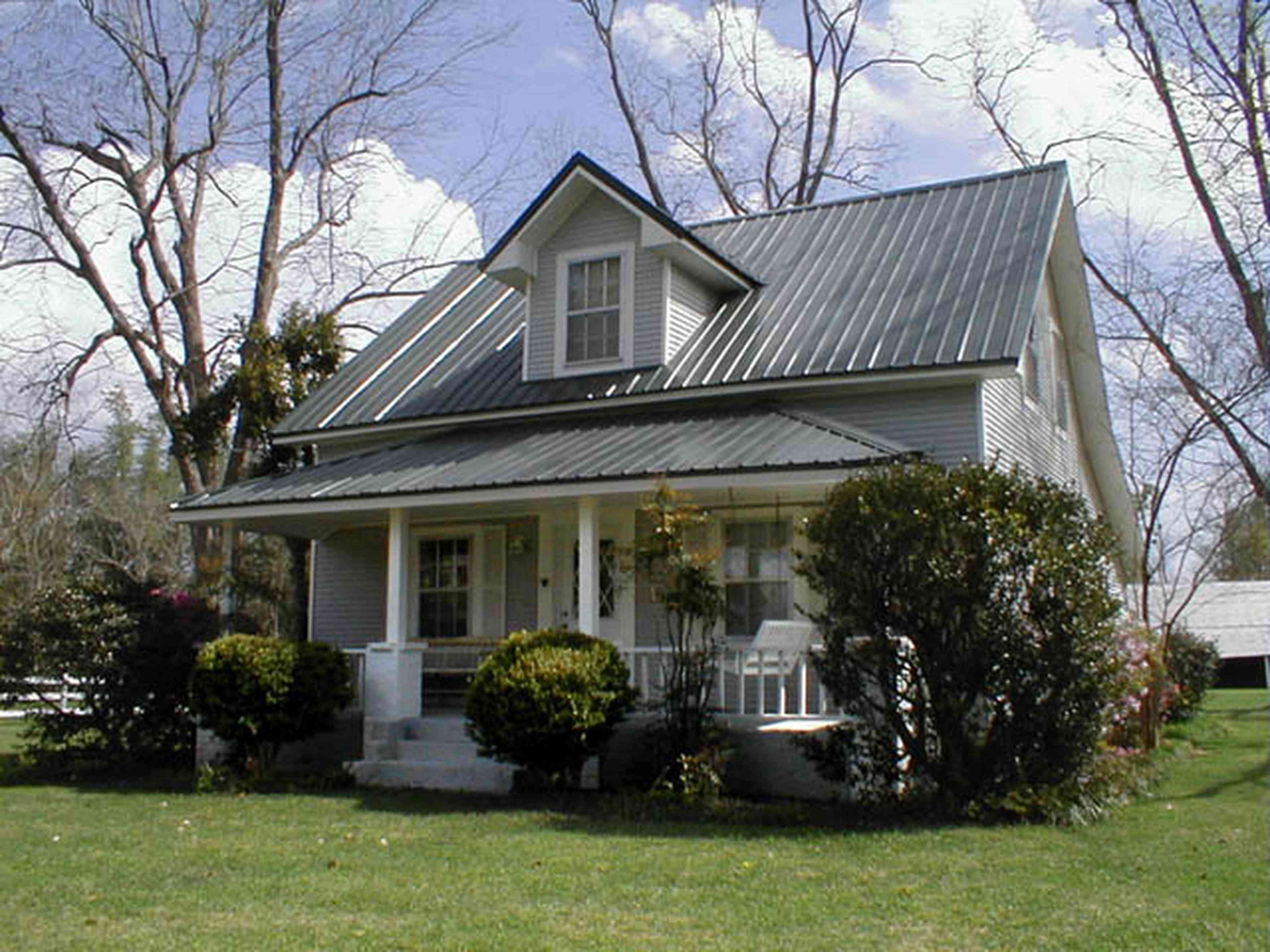 Molino:-Green-Farm_00.jpg:  1930's farm house, front porch, tin roof, pecan trees, farm, pasture, barn